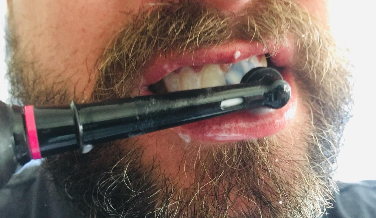 Guiding the CrossAction brush head around my teeth