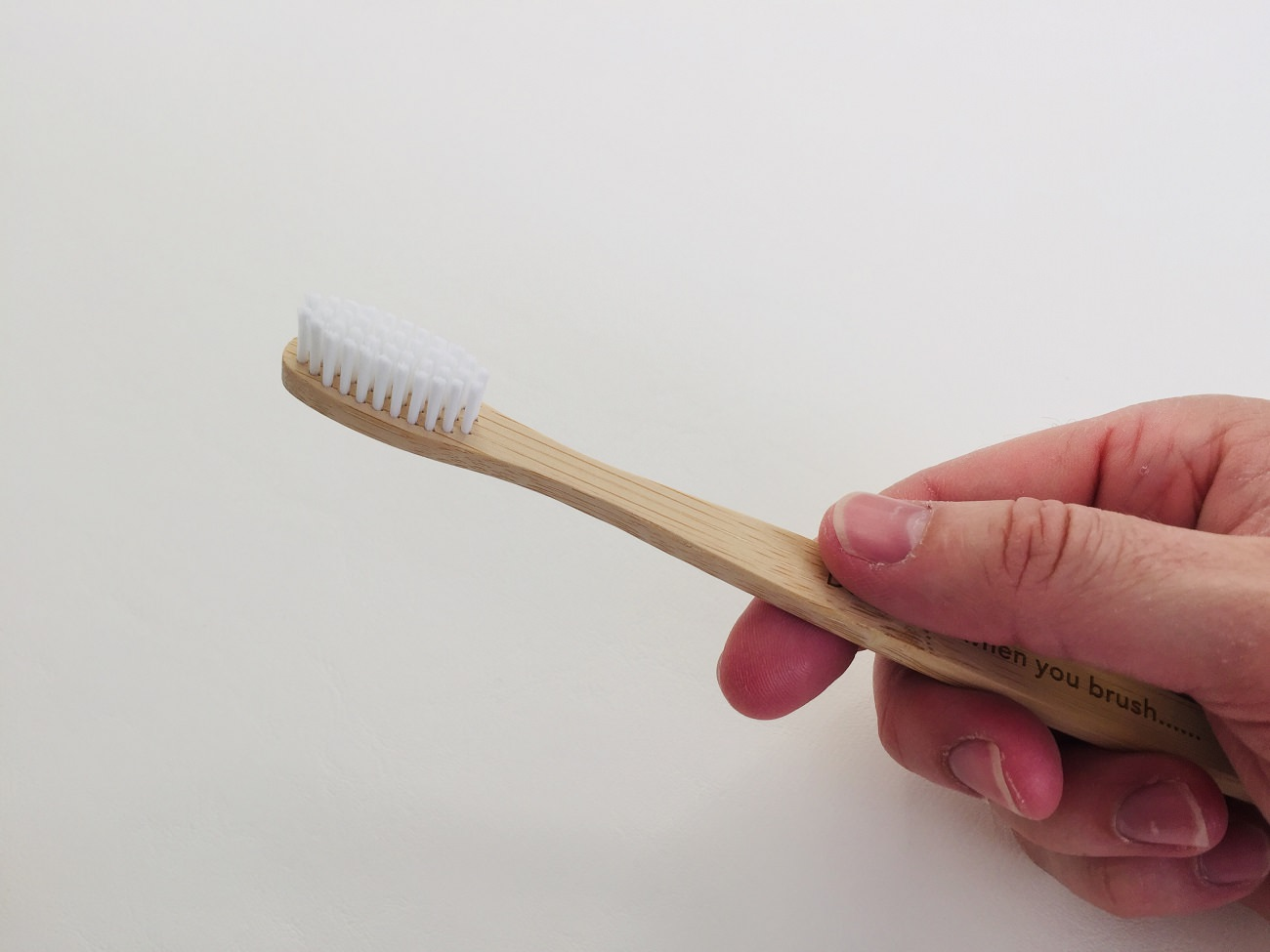 Holding the Flora & Fauna Bamboo Toothbrush