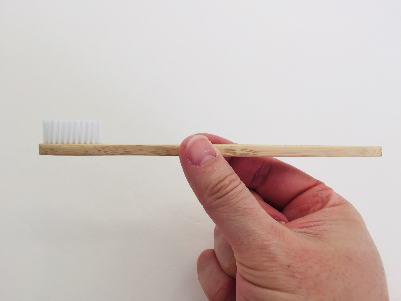 A side view of the Flora & Fauna Bamboo Toothbrush