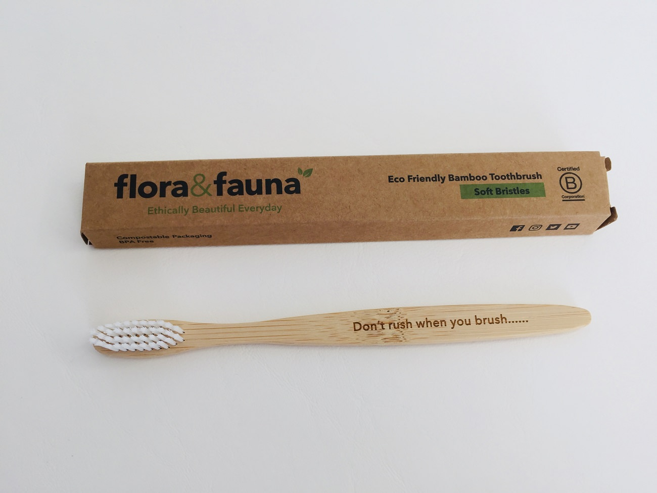 The Flora & Fauna Bamboo Toothbrush out of its packaging