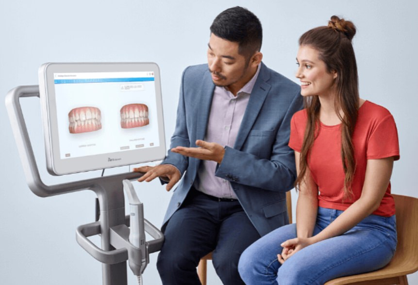 A lady speaking with her Invisalign provider