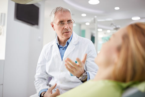 A patient speaking to their dentist about the treatment