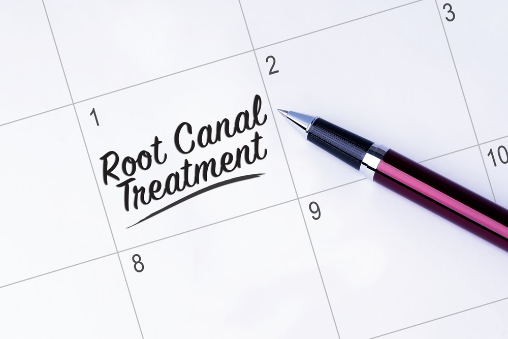 Writing a Root Canal Treatment appointment in a calendar