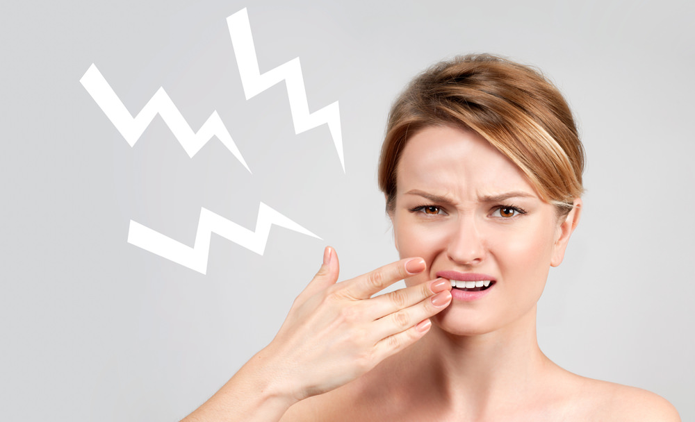 short sharp stabbing pains around your teeth and gums after teeth whitening at the dentist