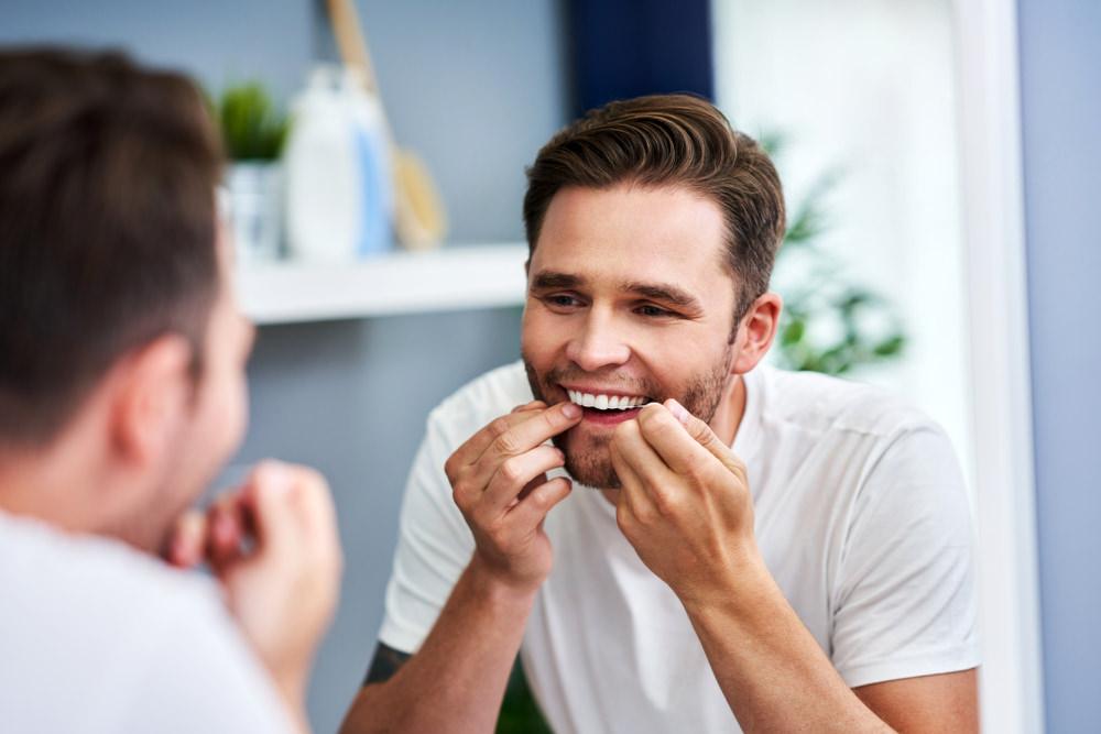 A man using dental floss