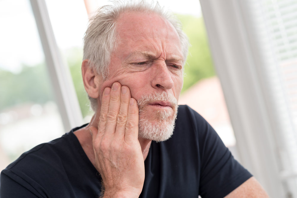 Older man with a toothache