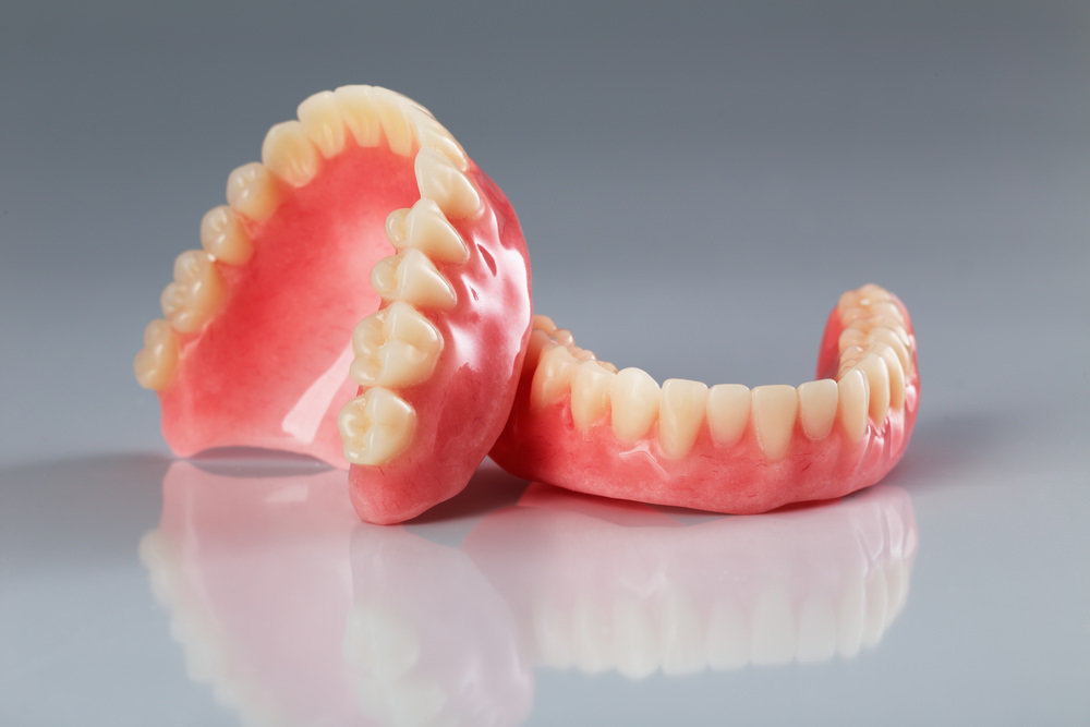 upper and lower sets of dentures