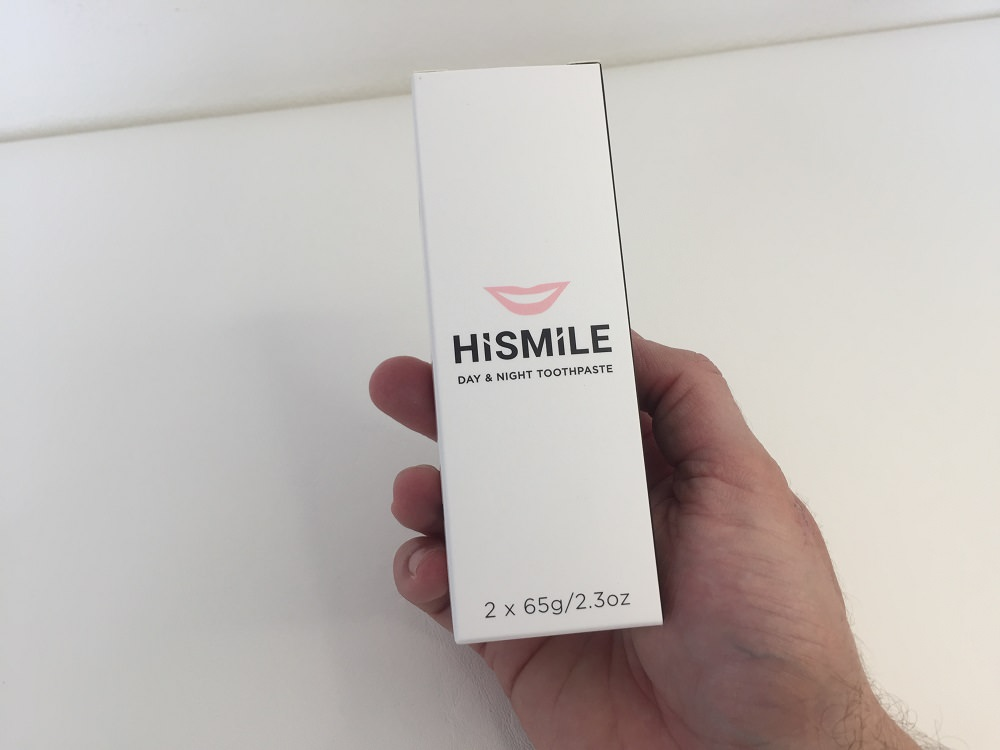 Holding the HiSmile Day and Night Toothpaste