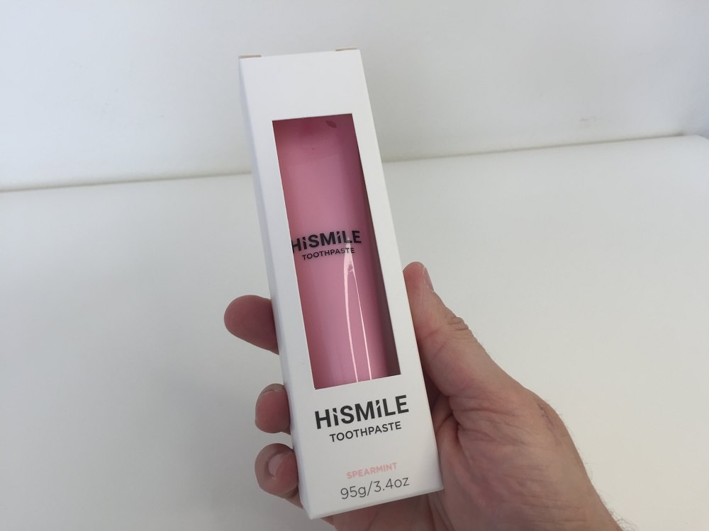 Holding the HiSmile Pink Toothpaste