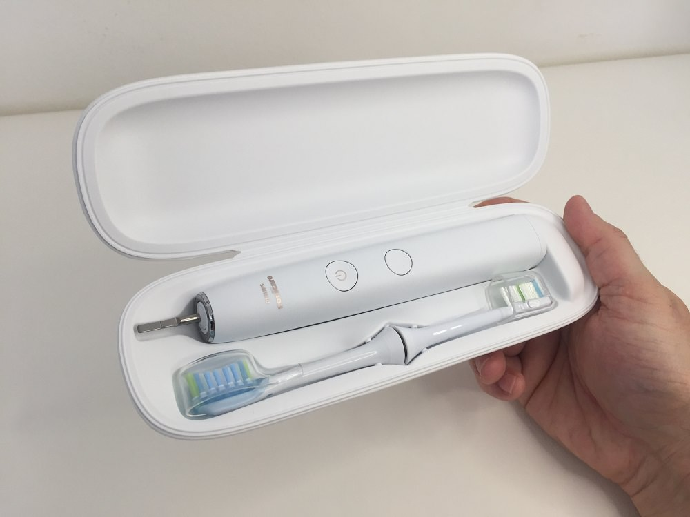 holding the 9000 electric toothbrush travel case with brush and brush heads