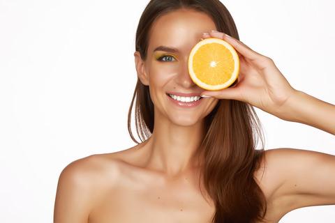 a woman with a orange cut in half