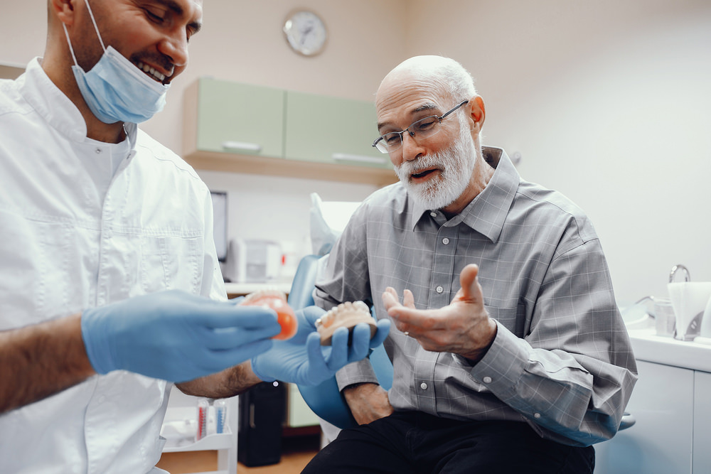 A man getting new dentures